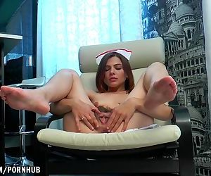 Erika massages her S/M pussy..